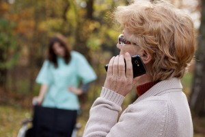 Elder disabled woman talking on the mobile phone